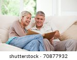 couple looking at their photo... | Shutterstock . vector #70877932