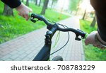 cyclist riding in a sunny... | Shutterstock . vector #708783229