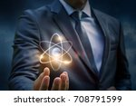 businessman showing an atom in... | Shutterstock . vector #708791599