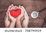 red heart on woman and child... | Shutterstock . vector #708794929