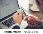 businessman cutting a credit... | Shutterstock . vector #708811441
