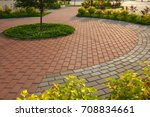paved with tiles path in the...