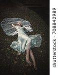 barefoot bride lie on grass and ... | Shutterstock . vector #708842989