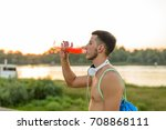 photo of a young man drinking...   Shutterstock . vector #708868111
