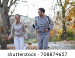 young couple jogging at the... | Shutterstock . vector #708874657