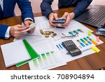 team working talking budget at... | Shutterstock . vector #708904894