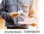 businessman checklist using... | Shutterstock . vector #708908059