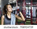 fitness asian woman taking a... | Shutterstock . vector #708924739