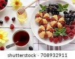 biscuit with fresh berries on... | Shutterstock . vector #708932911