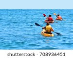 a group of kayaks are swimming... | Shutterstock . vector #708936451