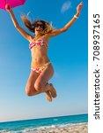 young beautiful blonde jumping... | Shutterstock . vector #708937165