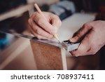 carpenter in the workshop makes ... | Shutterstock . vector #708937411