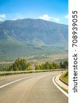 a road through the rural... | Shutterstock . vector #708939055