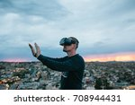 a man in virtual reality... | Shutterstock . vector #708944431