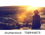 a tourist girl in a hat sits on ... | Shutterstock . vector #708944875