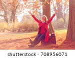 beautiful young woman siting on ... | Shutterstock . vector #708956071