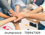 Small photo of Business partners teamwork or friendship concept. Multi-ethnic diverse group of colleagues join hands together. Creative team, coworkers, or college students in project meeting at modern office