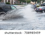 splash by car as it goes... | Shutterstock . vector #708985459