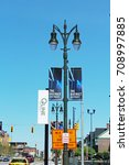 Small photo of Detroit, MI/USA: September 2, 2017 – An M1 Rail Q Line stop on Woodward Ave. The new streetcars use lithium ion batteries. District Detroit banners label 50 blocks of thriving entertainment district.