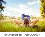Young Woman Lying On Grass...