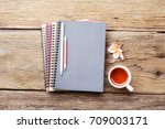 notebook and red tea on wooden... | Shutterstock . vector #709003171