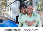 happy african american couple... | Shutterstock . vector #709014994