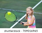 child playing tennis on outdoor ... | Shutterstock . vector #709016965