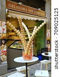 Small photo of Display of gelato or ice cream cones on the streets of Florence Italy , july 2017.