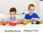 two child boy play repair toys | Shutterstock . vector #709037737