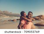 handsome african man giving... | Shutterstock . vector #709053769