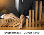 businessman hand stop dominoes... | Shutterstock . vector #709054549