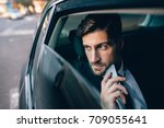 young businessman looking away... | Shutterstock . vector #709055641