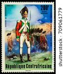 "Small photo of Moscow, Russia - September 05, 2017: A stamp printed in Central African Empire, shows English Grenadier Officer, series ""The 200th Anniversary of American Revolution"", circa 1976"