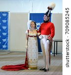 Small photo of BALASHIKHA, RUSSIA - AUGUST 24, 2013: Ladies and gentlemen in ballroom suits of the 19th century at the officer's ball.