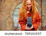 pretty photographer. long hair... | Shutterstock . vector #709101937