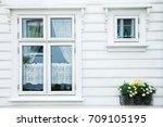 traditional norwegian wooden... | Shutterstock . vector #709105195