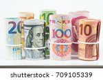 Stock photo currencies and money exchange trading concepts the rolls of various currencies us dollar euro and 709105339