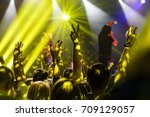 silhouette of hands up at the... | Shutterstock . vector #709129057
