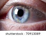 Macro shot of blue human eye focused on iris. - stock photo