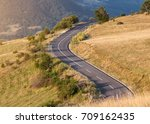 curved asphalt road in mountain ... | Shutterstock . vector #709162435