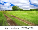 old rural road and cloudy blue sky - stock photo