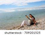 young couple making selfie... | Shutterstock . vector #709201525