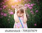 happy little girl in flower...   Shutterstock . vector #709207879