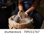 hands of man showing sack full... | Shutterstock . vector #709211767