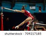 uneven bars female gymnast to... | Shutterstock . vector #709217185
