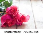 beautiful pink roses on table.... | Shutterstock . vector #709253455