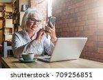 businesswoman in glasses is... | Shutterstock . vector #709256851