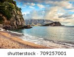 scenic beach with cliff and... | Shutterstock . vector #709257001