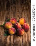 peaches on a wooden background   Shutterstock . vector #709257244