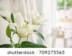 white bouquet of lilies on... | Shutterstock . vector #709275565